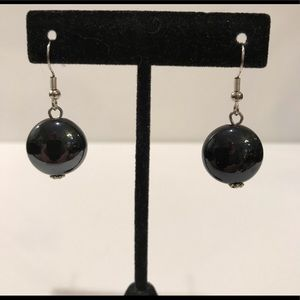 Simple yet elegant black silver pierced earrings.